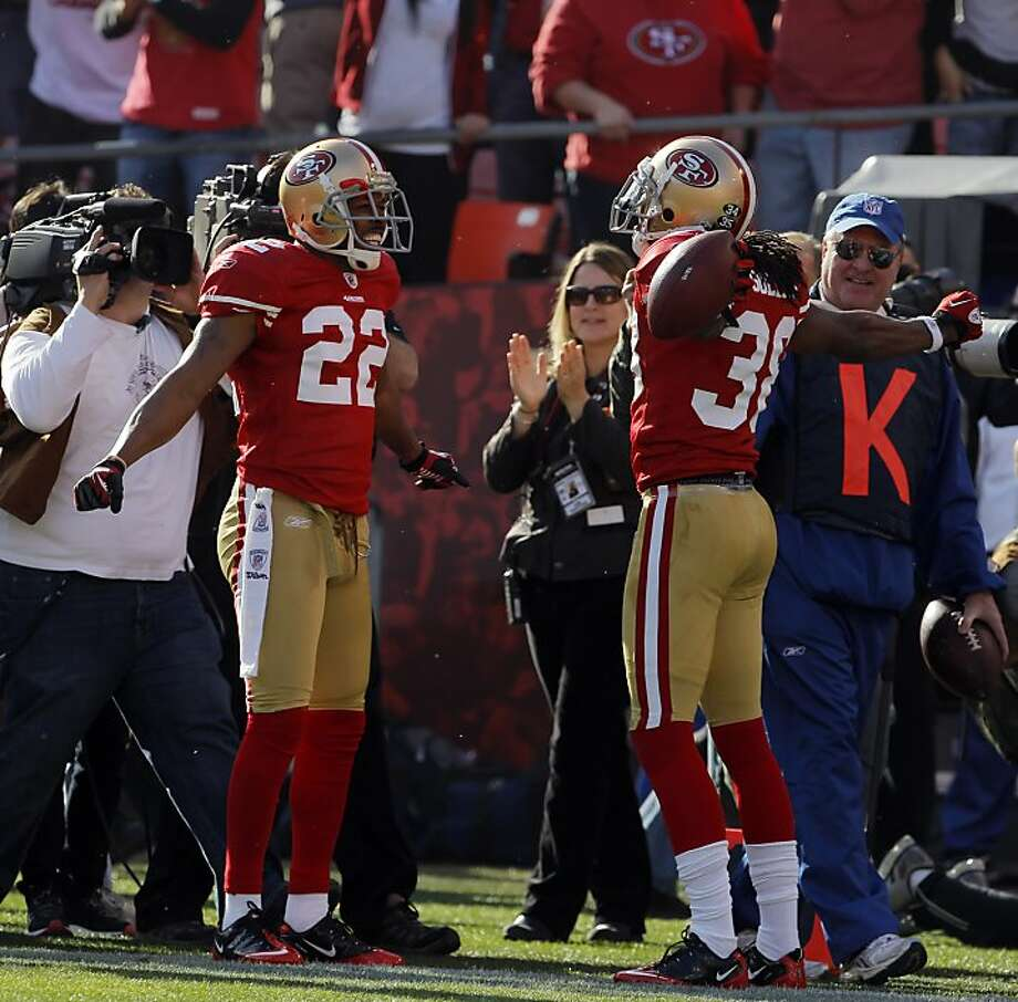 Carlos Rogers, left, and Dashon Goldson, right, celebrate Goldson's first quarter interception. The San Francisco 49ers played the New Orleans Saints in the NFC Divisional playoff game at Candlestick Park in San Francisco, Calif., on Saturday, January 14, 2012. Photo: Carlos Avila Gonzalez, The Chronicle