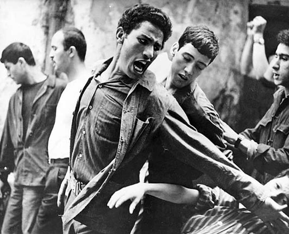 "ALGIERS13  Brahim Haggiag (center with arm outstretched) as revolutionary leader Ali La Pointe in a scene from ""The Battle of Algiers."""