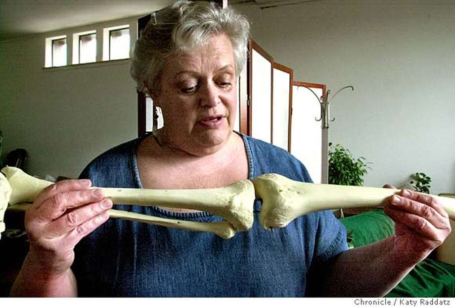 SHOWN: Joan Marie Passalacque describing and showing how very fragile the knee joint is. Joan Marie Passalacqua is a massage therapist in Berkeley, CA. who feels her colleagues should know about anatomy and pathology. She founded the Applied Anatomy Institute. Shoot date is 1/26/04; writer is Eve Kushner. Katy Raddatz / The Chronicle Photo: Katy Raddatz