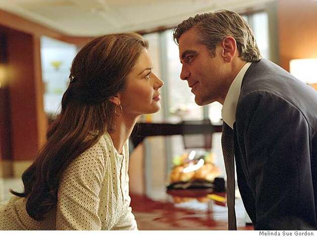 CRUELTY.jpg  CATHERINE ZETA-JONES as Marylin Rexroth and GEORGE CLOONEY as Miles Massey in the romantic comedy Intolerable Cruelty. PhotoCredit: Melinda Sue Gordon �2003 Universal Studios. ALL RIGHTS RESERVED. Photo: HO