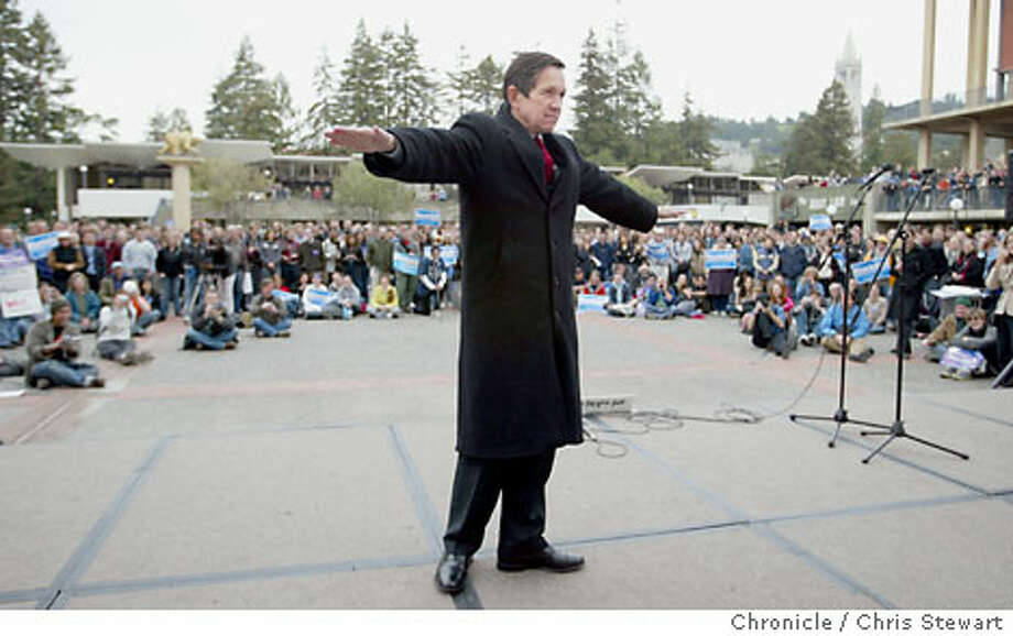 """Dennis Kucinich does a dead pan slow twirl to show """"no strings attached'' to corporate interests while speaking at Sproul Plaza. Chronicle photo by Chris Stewart"""