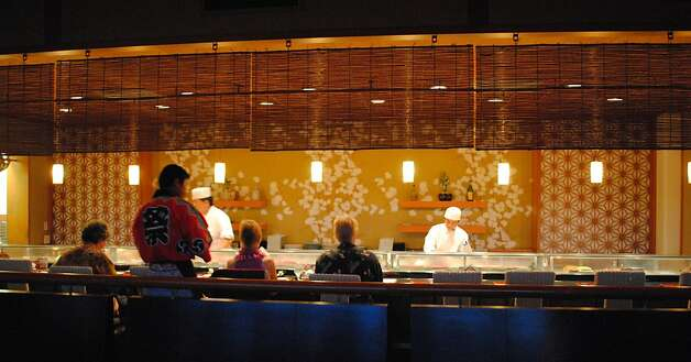 The bar at Raku, the new Japanese restaurant in the Makena Beach & Golf Resort on Maui, offers happy hour specials. Photo: Makena Beach & Golf Resort