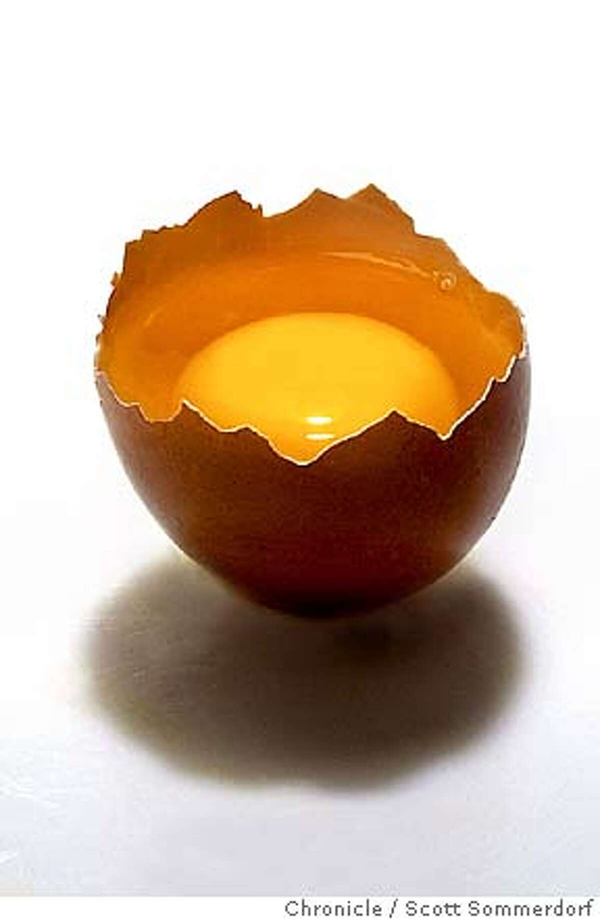 LEAD shot of a simple brown egg - broken with yolk visible, and lit nicely inside. This will be cut out and used (along with a little shadow) on the front of FOOD for the egg story. Gloria Orbegozo will be there to help style. SCOTT SOMMERDORF/THE CHRONICLE