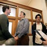 Andrew Nance, left, and Jim Maloney, right, both of San Francisco, hold hands while taking vows with witnesses, Leonardo Montenegro and Marcio Castro, both of San Francisco, at far right, at City Hall as many same sex marriages are permitted for the first time at City Hall. PHOTO BY DARRYL BUSH/CHRONICLE Event on 2/12/04 in San Francisco. DARRYL BUSH / The Chronicle