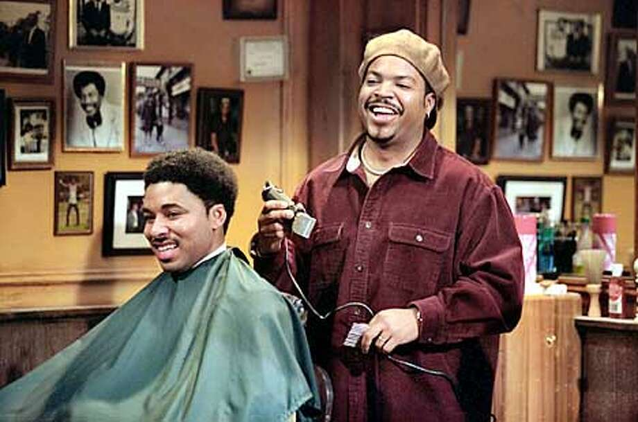 ICE CUBE (as Calvin) cutting up while cutting hair in Metro-Goldwyn-Mayer Pictures� ensemble comedy BARBERSHOP.  Photo by: Tracy Bennett (HANDOUT PHOTO) PLEASE VERIFY RIGHTS AND USAGE Photo: HANDOUT