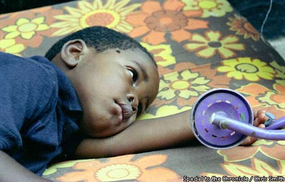 A child rests at Betty's Haven orphanage in South Africa. The country is struggling to cope with a growing population of AIDS orphans. Photo by Chris Smith, special to the Chronicle