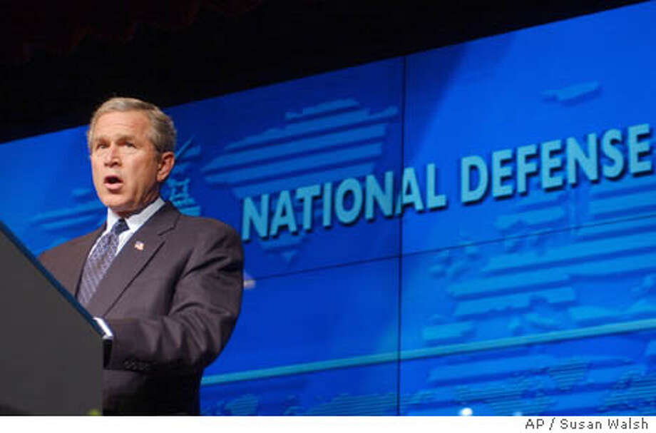 President Bush speaks at the National Defense University at Fort Lesley J. McNair in Washington, Wednesday, Feb. 11, 2004. Bush, pointing to a black market weapons network led by the father of Pakistan's nuclear bomb, said Wednesday that no new countries should have the ability to enrich or process nuclear material. (AP Photo/Susan Walsh) Photo: SUSAN WALSH