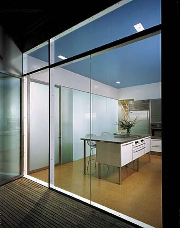 Bouncing Light: Special glass panels Anne Fougeron adapted for her kitchen allow light to radiate across the room.