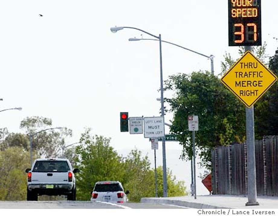 STOPLIGHT_07104_LI.JPG event on 4/6/04 in PLEASANTON Pleasanton this week will become the first Bay Area city to use a traffic signal that punishes speeders. It stays green if you are going less than the speed limit of 35 mph, but turns red if you are heavy on the gas. It's made possible by a camera that captures your speed connected to the signal	at the corners of Vineyard Ave and Montevino Drive  By Lance Iversen/The San Francisco Chronicle Photo: Lance Iversen