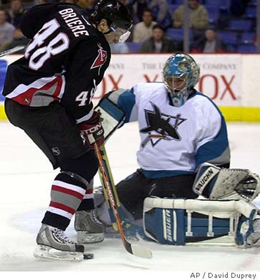 Buffalo Sabres' Daniel Briere (48) has a shot blocked by San Jose Sharks goalie Evgeni Nabokov of Kazakstan, during the first period of the game at HSBC Arena in Buffalo, N.Y., Tuesday Feb. 10, 2004. (AP Photo/David Duprey) Photo: DAVID DUPREY