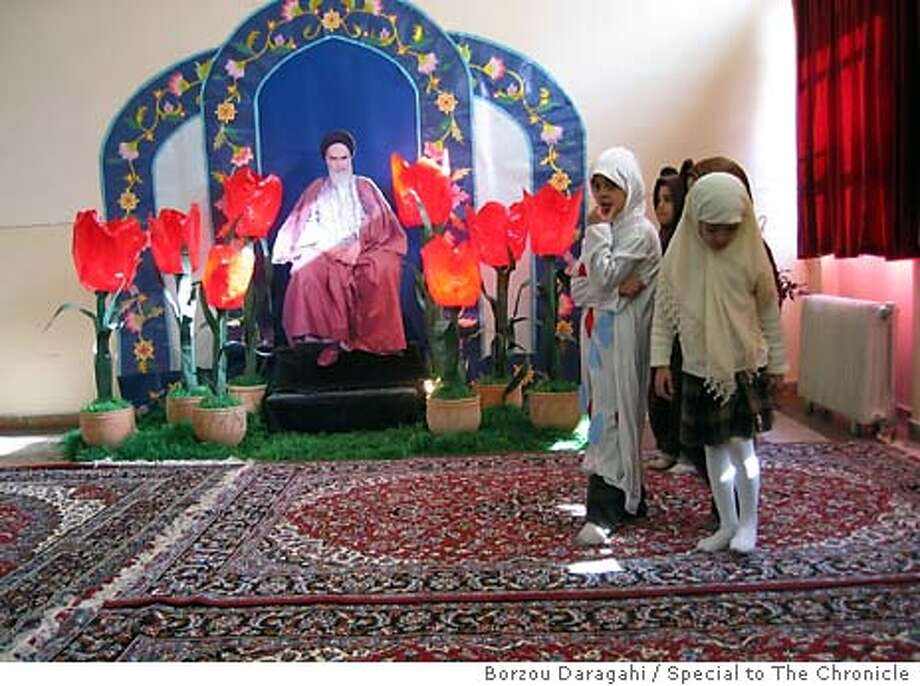/ for: Foreign Students gather for a school play in the Imam Khomeini Room of the Refah School, where Khomeini once slept. Photo by Borzou Daragahi on Feb. 3, 2004 � Photo: Borzou Daragahi