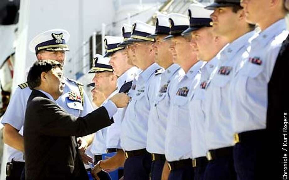 9 11 01 / ONE YEAR LATER / Coast Guard honors 21 heroes