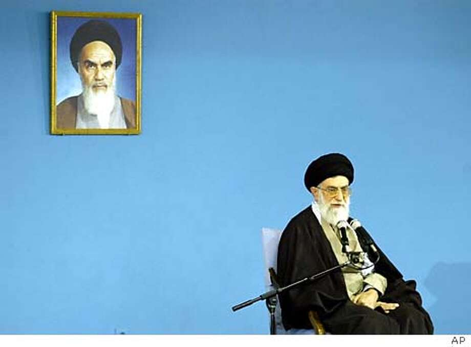 Iran's supreme leader Ayatollah Ali Khamenei, delivers his speech during a public meeting in Tehran Wednesday Feb. 4, 2004. Khamenei, has ordered a review of the candidates disqualified from legislative elections. At top left is a photo of Iran's late revolutionary leader Ayatollah Khomeini. (AP Photo/STR) Ayatollah Ali Khamenei, Iran's religious leader, broke the impasse between reformists and the conservative Guardian Council, which banned thousands of reformist candidates. Photo: STR