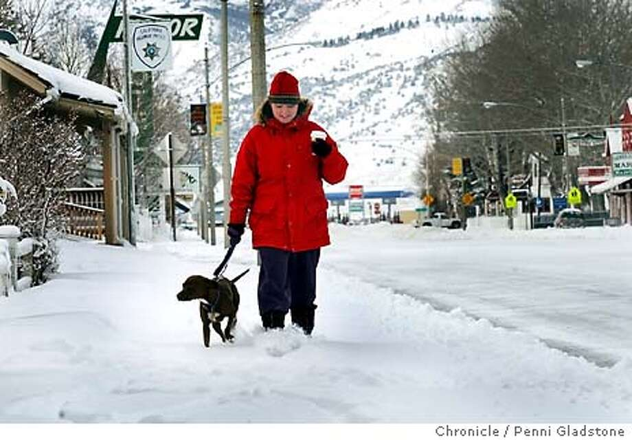 COLD  Melissa Barthel, hot drink in hand, and her dog Sasha take a morning walk on the main street of Bridgeport.  Bridgeport and Bodie have temperatures 35 degrees and below in the winter. We talk to the people who live here. 2/3/04 in Bridgeport.  PENNI GLADSTONE / The Chronicle Photo: PENNI GLADSTONE