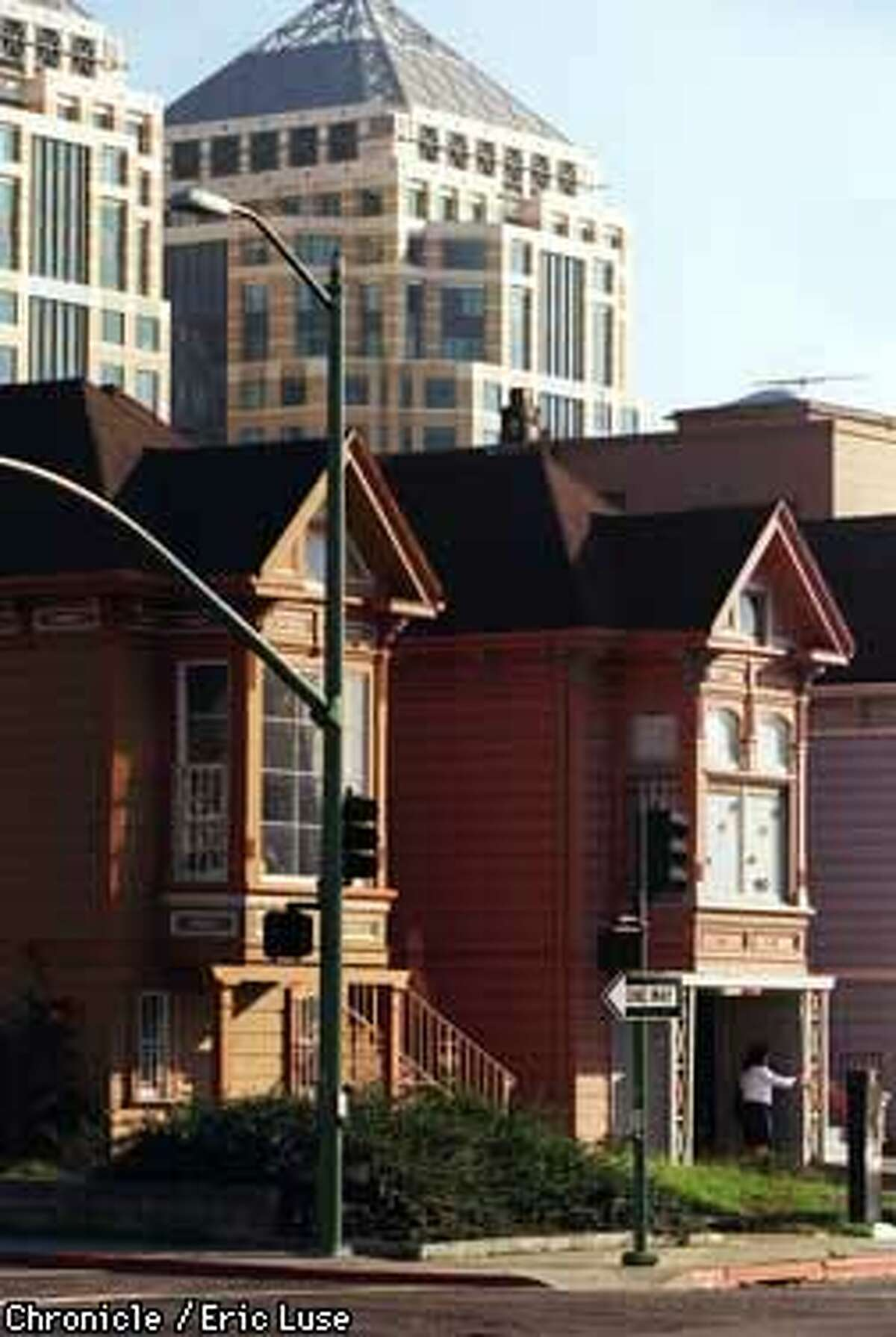 Oakland's row of haunted houses at 17th and Castro with downtown Oakland in the backgorund. Photo by Eric Luse