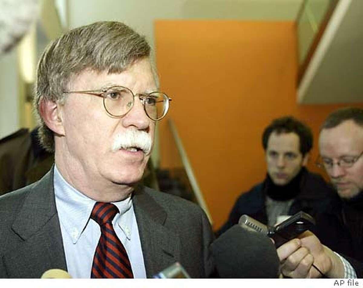 U.S. Undersecretary of State John Bolton talks to journalists, on Monday, Jan. 19, 2004, after negotiations with Director General of the International Atomic Energy Agency (IAEA) Mohamed ElBaradei on Libya's nuclear program at Vienna's International Center. (AP Photo/Rudi Blaha)