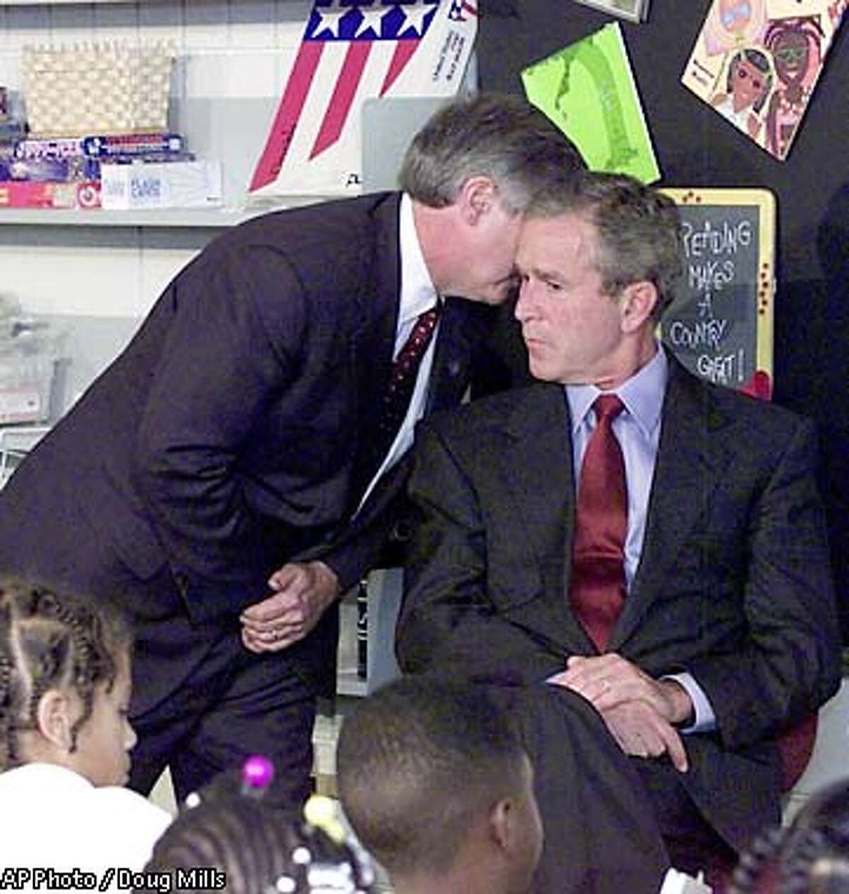 President Bush's Chief of Staff Andy Card whispers into the ear of the President to give him word of the plane crashes into the World Trade Center, during a visit to the Emma E. Booker Elementary School in Sarasota, Fla., Tuesday, Sept. 11, 2001. (AP Photo/Doug Mills) .. ALSO RAN 09/23/2001, SPECIAL SECTION