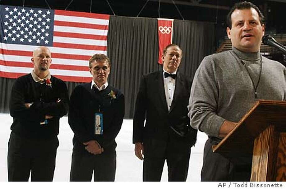 "Mike Eruzione, right, captain of the1980 U.S. Olympic hockey team, speaks to attendees of a reception Thursday, Feb. 5, 2004, at the Olympic Center in Lake Placid, N.Y., prior to a screening of the film ""Miracle."" Also on the ice are 1980 Olympic hockey team members Jack O'Callahan, left, and Buzz Schneider along with New York Gov. George Pataki. (AP Photo/Todd Bissonette) Photo: TODD BISSONETTE"