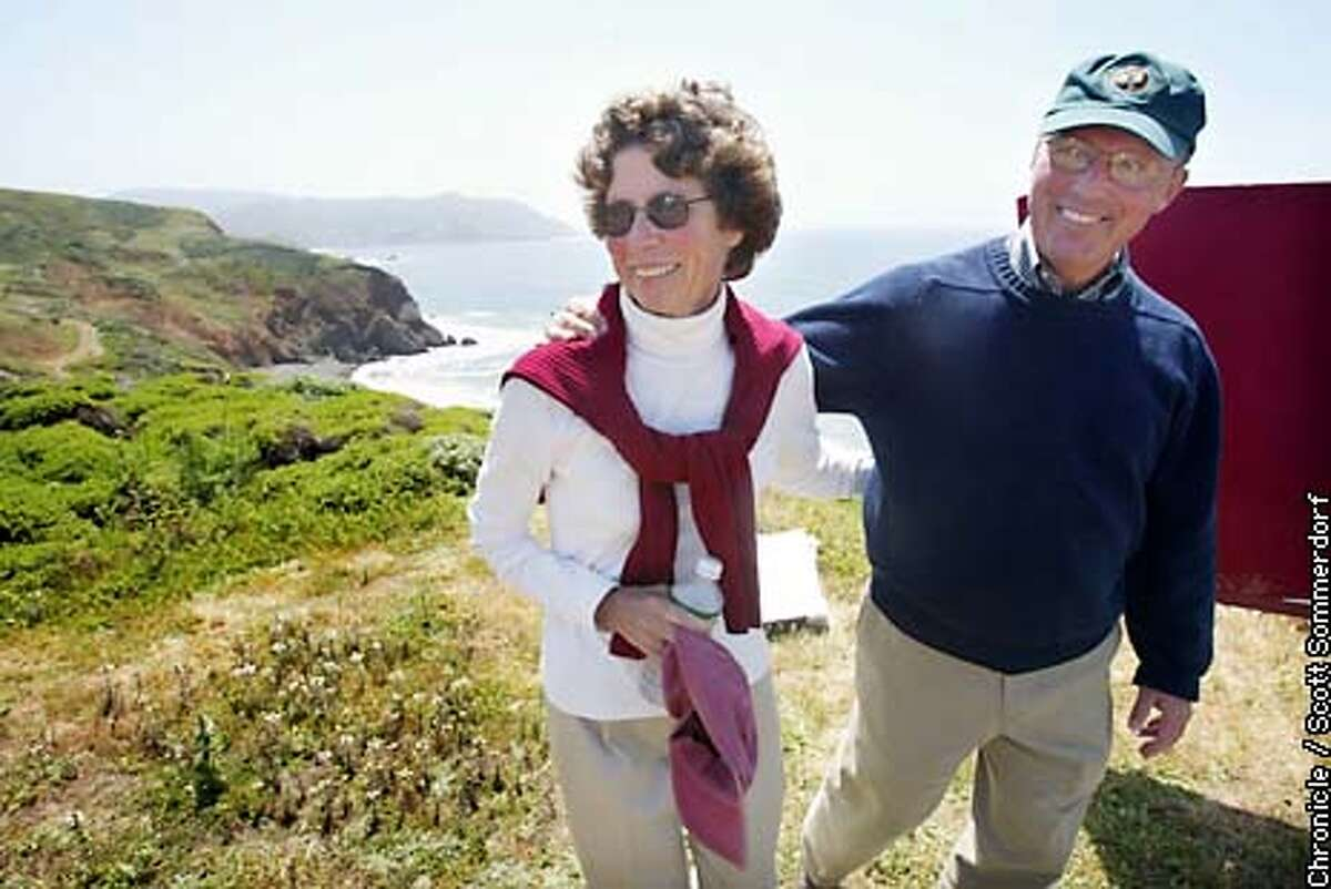 John Reynolds walks with his wife Bobbie (CQ) near the Mori Point site that was added to the GGNRA on Sunday, May 5th, 2002. Reynolds is retiring after being the XXXXX of the National Parks Dept. (SF CHRONICLE PHOTO BY SCOTT SOMMERDORF)