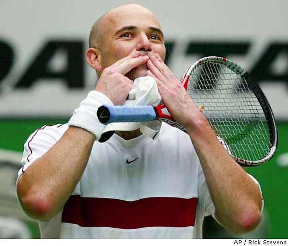 70d3a03353ca4c Andre Agassi of the U.S. blows kisses to the crowd following his fourth  round match against