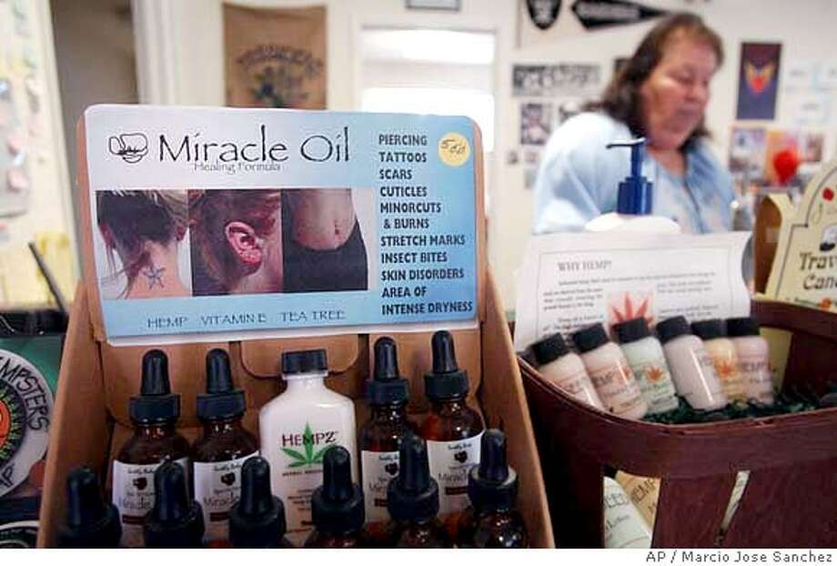 Medicinal ointments made from hemp are sold at the front counter of a dispensary in Hayward, Calif., Friday, Feb. 6, 2004. Rejecting one front of the government's drug war, a federal appeals court in San Francisco ruled Friday the United States cannot ban the sale of food made with natural hemp that contains only trace amounts of the psychoactive chemical in marijuana. (AP Photo/Marcio Jose Sanchez) Photo: MARCIO JOSE SANCHEZ