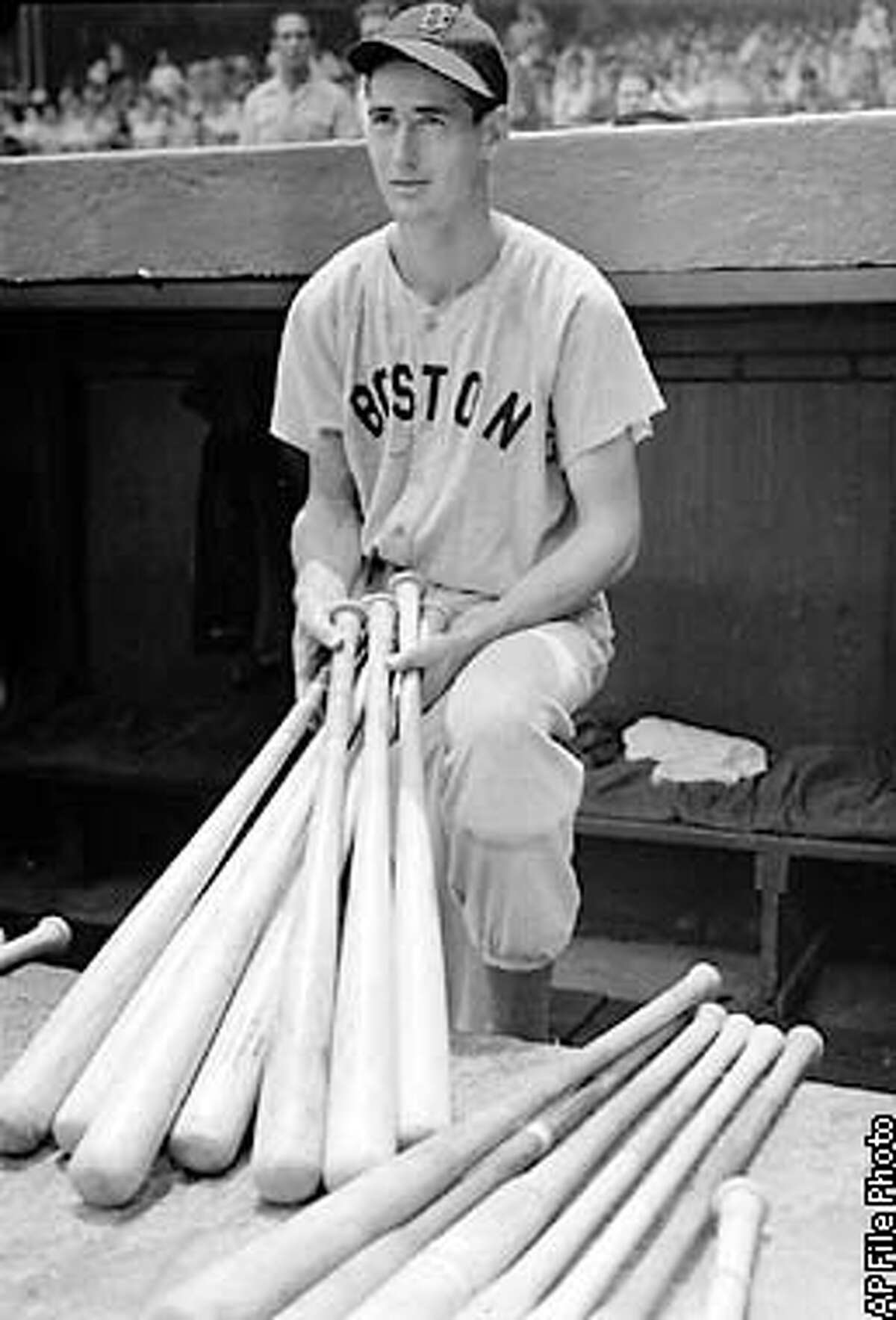 **FILE**Boston Red Sox outfielder Ted Williams is shown at Yankee Stadium in the dugout selecting bats before a game in this July 1, 1941 file photo. Williams, the Boston Red Sox revered and sometimes reviled ``Splendid Splinter'' and baseball's last .400 hitter, died Friday, July 6, 2002 in Crystal River, Florida. He was 83. (AP Photo, File)