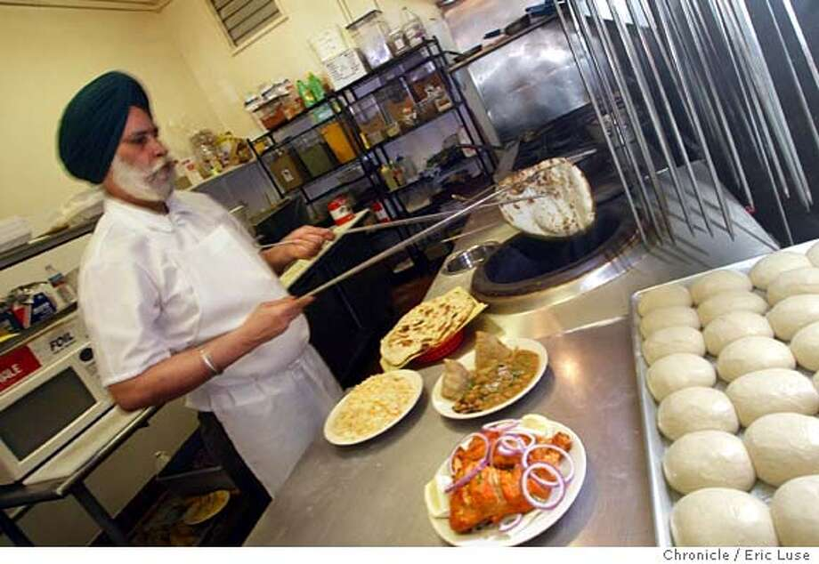 Piara Sing, Tandori Chef bringing out freshly baked Naan bread. The other dishes are Tandori Chicken, Sasamosa and Safron RIce.  Naan n Chutney at 525 Haight Street in San Francisco. Event on 3/24/04 in San Francisco.  Eric Luse / The Chronicle Photo: Eric Luse