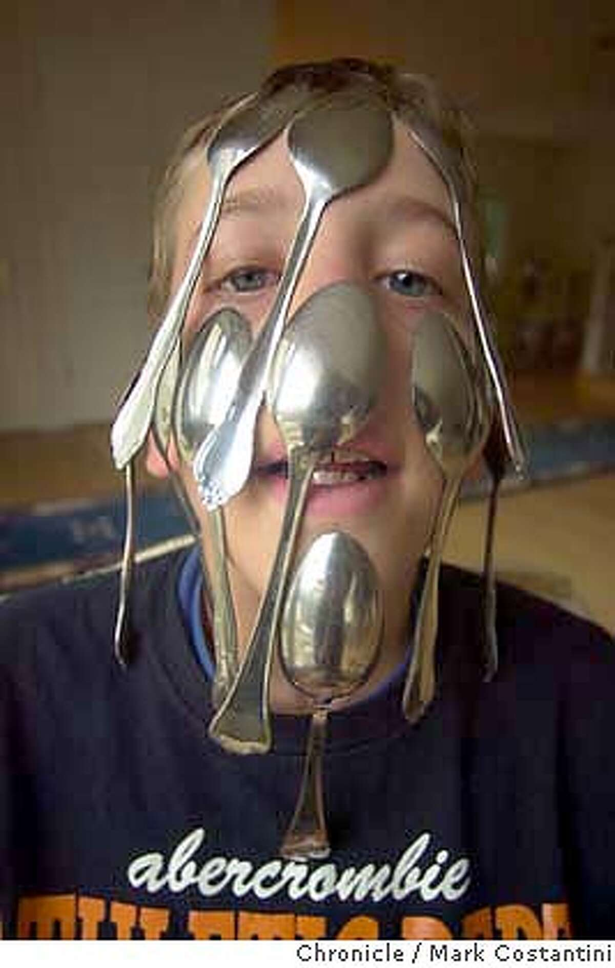 spoons_0087.JPG Photo taken on 1/30/04 in Peidmont. Tim Johnston, a Piedmont fifth grader, can attach more spoons to his face than any other human being on earth. His record is 22. Guinness says it's official. We go watch him do this and ask him why and what for. CHRONICLE PHOTO BY MARK COSTANTINI Tim Johnston demonstrates the technique that may soon put him in the Guinness Book.