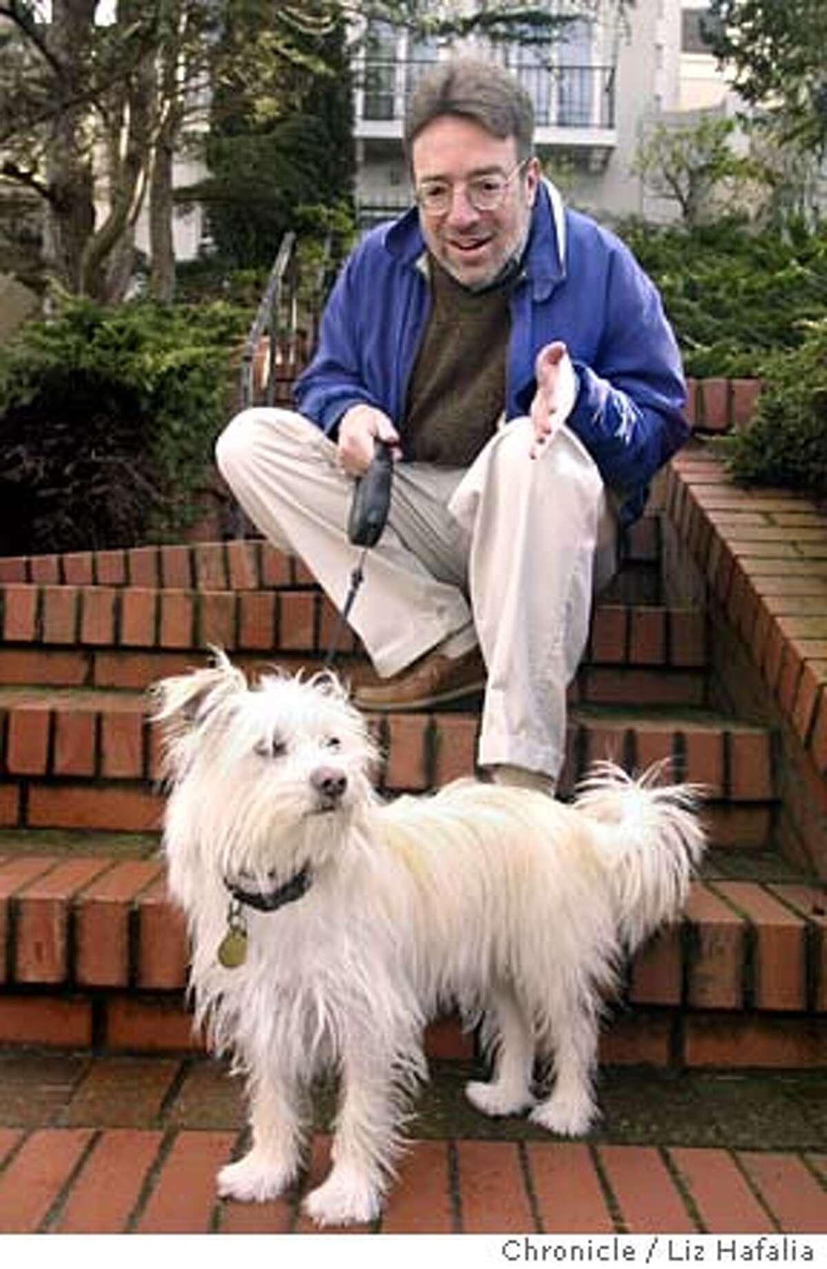 Steven Winn talking with the family dog, Como, during his walk. Shot on 2/4/04 in San Francisco. LIZ HAFALIA / The Chronicle