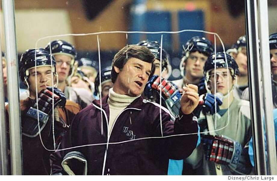 Coach Herb Brooks (Kurt Russell, center) is told that his group of college players dont stand a chance at the 1980 Olympic Games against the juggernaut from the Soviet Union, but the visionary coach leads his underdog team to an improbable victory in Walt Disney Pictures inspirational new film, Miracle. (AP Photo/Chris Large) Kurt Russell (center) is U.S. coach Herb Brooks, who maps out a strategy for his Olympic hockey team in &quo;Miracle.&quo; Photo: CHRIS LARGE