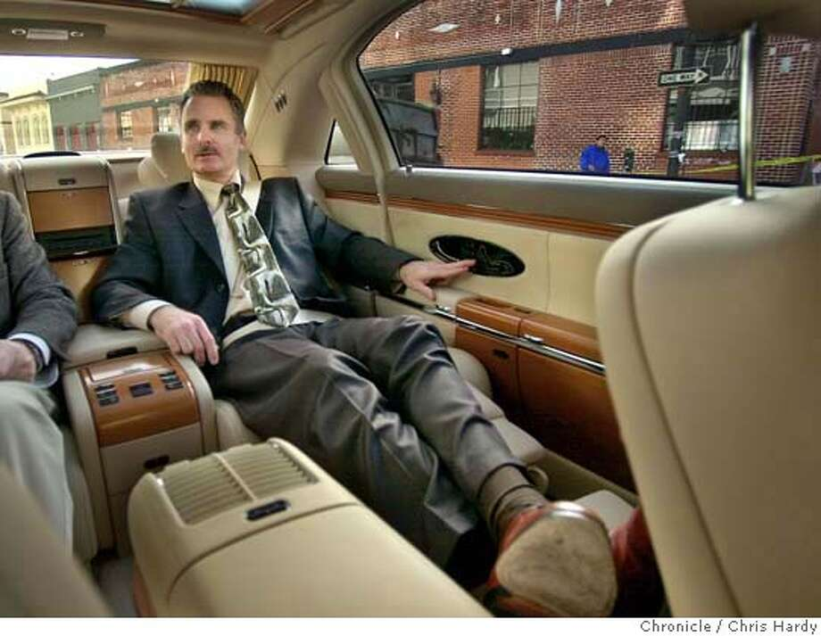 Story talks about super-expensive cars and who buys them and why. DaimlerChrysler is letting us have the $350,000 Maybach luxo-car .  CHRIS HARDY / The Chronicle Photo: CHRIS HARDY
