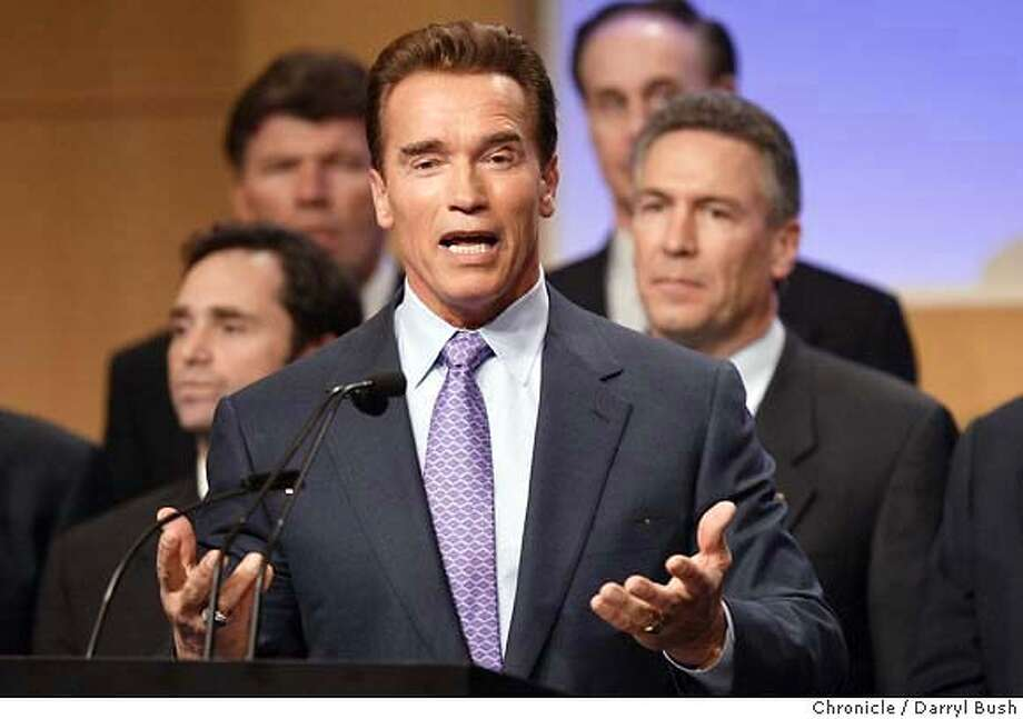 schwarzenegger004db.jpg  Governor Arnold Schwarzenegger addresses a crowd of business people from stage with several CEOs and members of the Silicon Valley Manufacturing Group, at Adobe Systems headquarters. The group endorses Schwarzenegger's recovery plan including Props. 57 & 58. 2/5/04 in San Jose. DARRYL BUSH / The Chronicle Photo: DARRYL BUSH