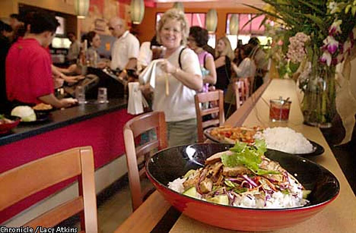 Casual Chinese: At Yan Can in Pleasant Hill, diners order dishes like Spice Roads Chicken at the counter, then head to a table to wait for delivery. Chronicle photo by Lacy Atkins