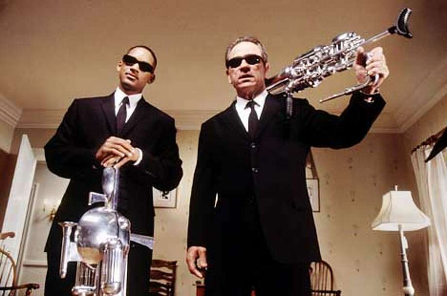 "Agents Jay (Will Smith) and Kay (Tommy Lee Jones) return to protect the universe from alien forces in the good-natured ""Men in Black II."" Photo by Melinda Sue Gordon"
