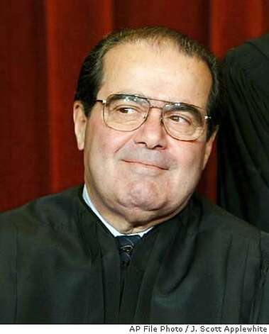 U.S. Supreme Court Associate Justice Antonin Scalia poses for photos during a group portrait session with the members of the U.S. Supreme Court, at the Supreme Court Building in Washington, Friday, Dec. 05, 2003. Former President Ronald Reagan nominated Scalia to the Supreme Court and has held his position since Sept. 26, 1986. (AP Photo/J. Scott Applewhite) Photo: J. SCOTT APPLEWHITE