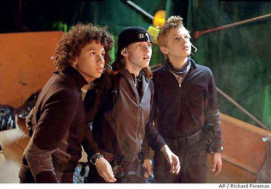 """Corbin Bleu, Kristen Stewart and Max Thieriot gaze in awe at the challenge before them: robbing an impregnable, state-of-the-art safe suspended 100 feet in the air in 20th Century Fox's """"Catch That Kid."""" (AP Photo/ Richard Foreman) Photo: RICHARD FOREMAN"""