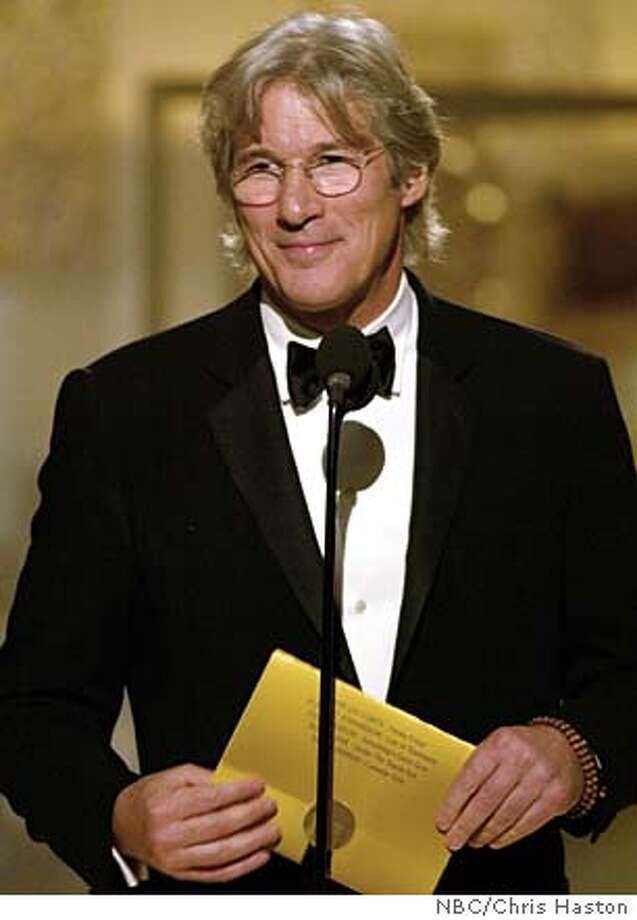 Actor Richard Gere acts as a presenter during the 61st annual Golden Globe Awards in Beverly Hills January 25, 2004. MANDATORY CREDIT FOR EDITORIAL USE ONLY REUTERS/Chris Haston/NBC/Handout 0 Photo: CHRIS HASTON