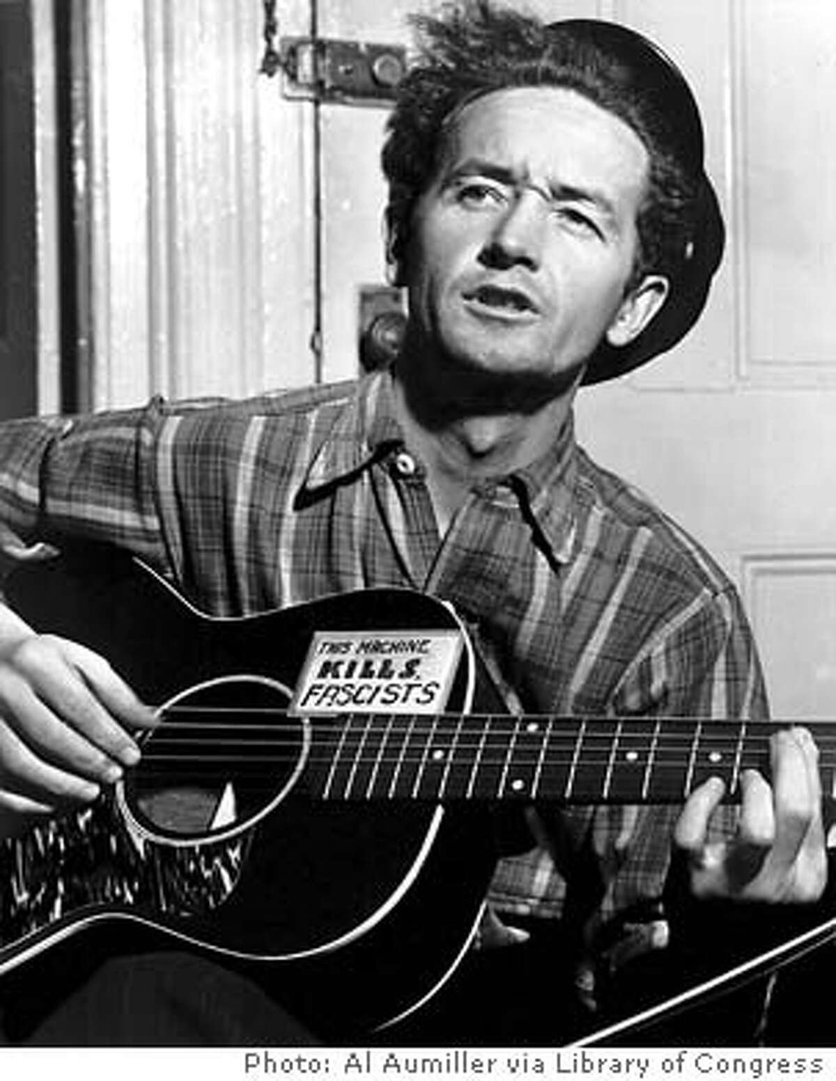 """CU31-B-18MAR02-PK-HO --- Legendary folk singer Woody Guthrie will be the subject of a book talk and musical tribute to celebrate his 90th birthday. On April 1, 2002 at 6:00 pm, Elizabeth Partridge, author of the new biography, """"This Land Belongs To You and Me: The Life and Music of Woody Guthrie,"""" will give a slide-illustrated talk on Guthrie followed by a musical tribute with Country Joe McDonald. The event will take place at the San Francisco Performing Arts Library & Museum, 401 Van Ness Avenue, Veterans Building, 4th Floor. Space is limited and advance tickets are recommended. Call 415-255-4800. For more information, visit www.sfpalm.org. Photo Credit: Al Aumiller, courtesy Library of Congress. (HANDOUT PHOTO)"""