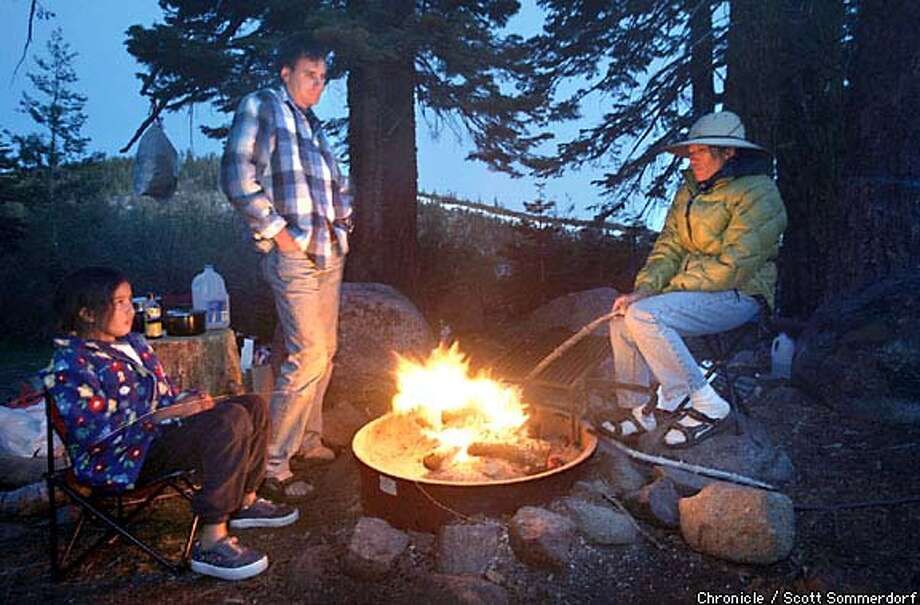 Crackling yarns: Sidara, Oliver and Sumana Meissner of Pleasanton tell stories around their campfire between Carr and Feeley lakes, near Nevada City. Chronicle photo by Scott Sommerdorf
