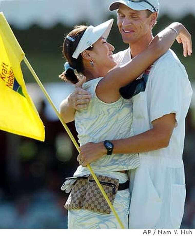 Grace Park, of South Korea, celebrates with her caddie David Brook after she won the LPGA 2004 Kraft Nabisco Championship at Mission Hills Country Club, Sunday, March 28, 2004, in Rancho Mirage, Calif. Park finished 11 under. (AP Photo/ Nam Y. Huh) Grace Park gives caddie David Brooker, who helped her make a key decision on the 18th, a hug after wrapping up her first major. Photo: NAM Y HUH