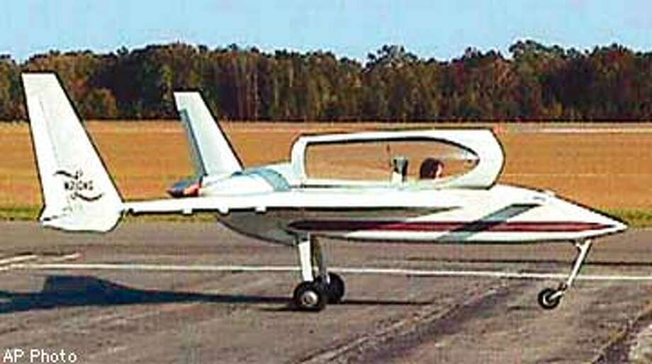 This is a Saturday, Oct. 11, 1997 photo of a Long Ez plane in Salisbury, Md., similar to the plane that crashed in California's Monterey Bay on Sunday, Oct. 12, 1997, killing singer John Denver. National Transportation Safety Board spokesman George Peterson said Denver had just bought the plane and had performed three practice touch-and-go landings at the Monterey Peninsula Airport. (AP Photo/Canard Aviators) Photo: WAYNE WRIGHT