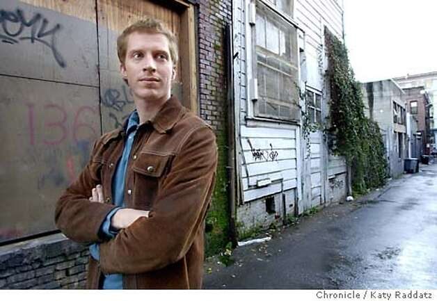 "Andrew Sean Greer is a brilliant new author based in San Francisco. His novel, ""The Confessions of Max Tivoli"" just won a rave review from John Updike in the New Yorker. SHOWN: Greer in a South Park alley, where the hero of his novel is raised. Shoot date is 1/27/04; writer is Edward Guthmann. Katy Raddatz / The Chronicle Photo: Katy Raddatz"