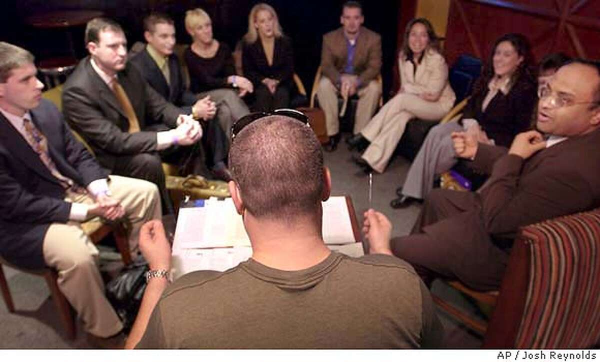 Casting Director Brendon Blincoe, back to camera, speaks to a group of applicants during auditions for NBC's The Apprentice held in Boston on Saturday, March 20, 2004. (AP Photo/Josh Reynolds)
