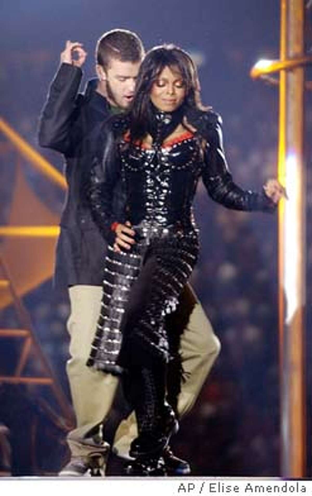 Justin Timberlake and Janet Jackson perform during halftime of Super Bowl XXXVIII Sunday, Feb. 1, 2004, in Houston. The chief federal regulator of broadcasting was outraged by the Super Bowl halftime show and ordered an investigation after part of Jackson's costume was torn off, exposing her breast. (AP Photo/Elise Amendola)