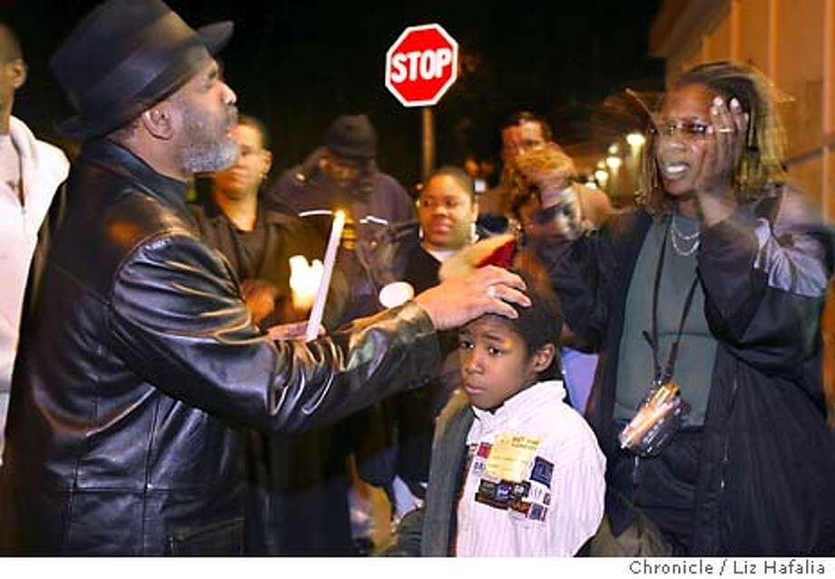 PEACEMAKERS in Operation Save A Life get together Friday nights at Sunnydale Ave. and Hahn in attempts to stop violence and death in the district. Rev. Ishmael Burch blesses 8 year old Edwin Ryan. Pam Pam Gaddies (cq) at right.  Liz Hafalia/The Chronicle  Shot {01/30/04} in {San Francisco} Photo: LIZ HAFALIA