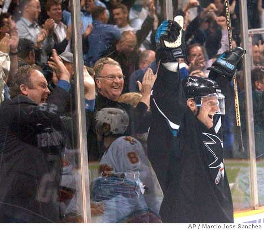 San Jose Sharks' Vincent Damphousse raises his hands in celebration after scoring the game-winning goal against the Calgary Flames during the third period in San Jose, Calif., on Thursday, March 25, 2004. San Jose won 3-2. (AP Photo/Marcio Jose Sanchez) Photo: MARCIO JOSE SANCHEZ