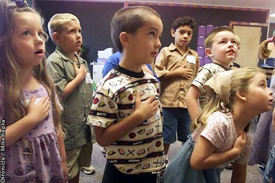A room full of 5-year-olds say the pledge of allegiance for the first time in Laura Vojvoda' s kindergarten class at Loma Vista Elementary School in Brentwood. BY MIKE KEPKA/THE CHRONICLE Photo: MIKE KEPKA