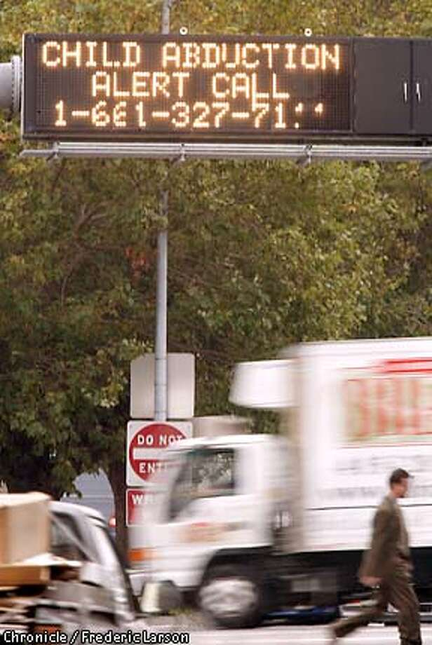 In this file photo, an Amber Alert sign is displayed at the entrance of Highway 280 at Sixth and Brannan Street in San Francisco.  An Oakland woman triggered a fase Amber Alert on Thursday after accusing an acquaintance with stealing a baby. Photo: FREDERIC LARSON