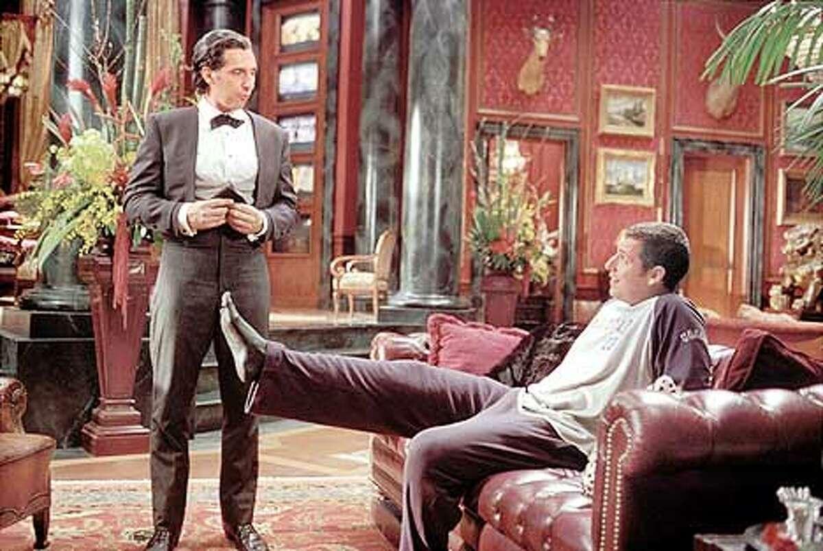 D-113 Photo Credit: Jon Farmer Longfellow Deeds (Adam Sandler, right) jokes with his trusty valet, Emilio (John Turturro) in the Columbia Pictures/New Line Cinema comedy, Mr. Deeds (HANDOUT PHOTO)