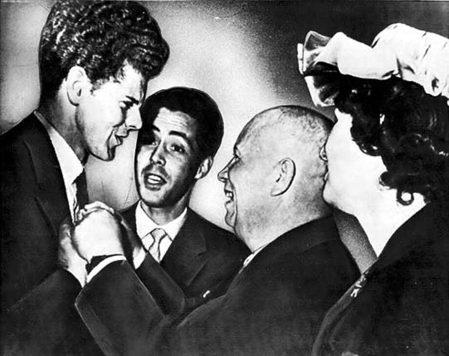 April 15, 1958: Val Cliburn, left, tall Texan who won Soviet Union's International Tchaikovsky piano contest, gets unstinted congratulations of Premier and Communist Party boss Nikita Khrushchev at reception in Moscow yesterday. In background is interpreter and at right is wife of Llewellyn Thompson U.S. Ambassador to Russia.